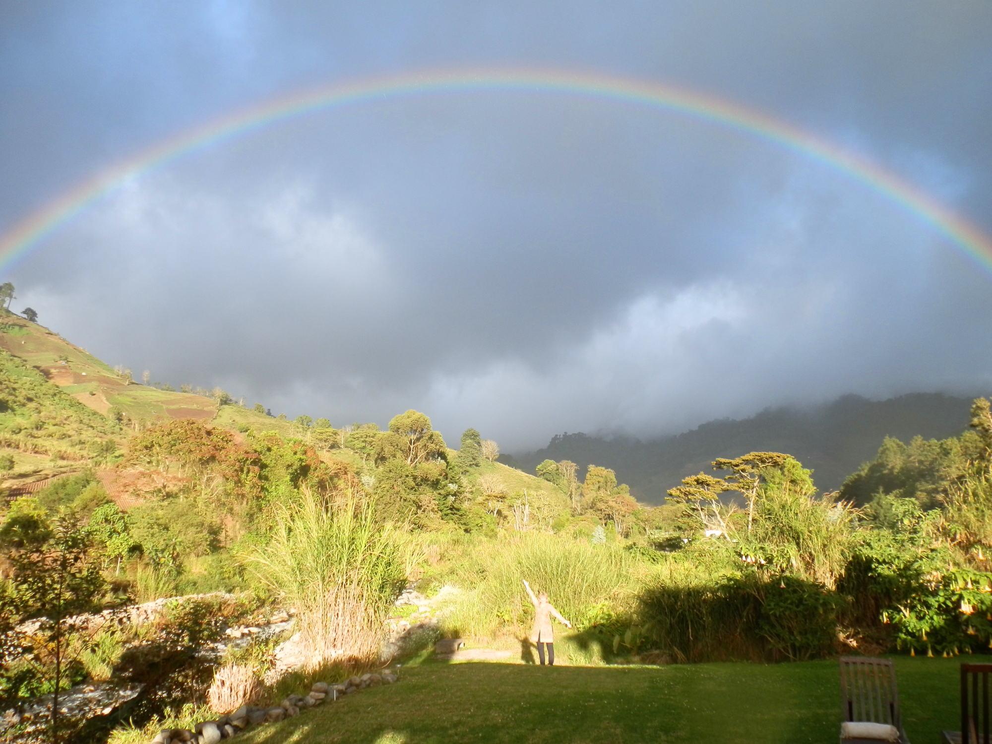 Gudrun standing under a rainbow