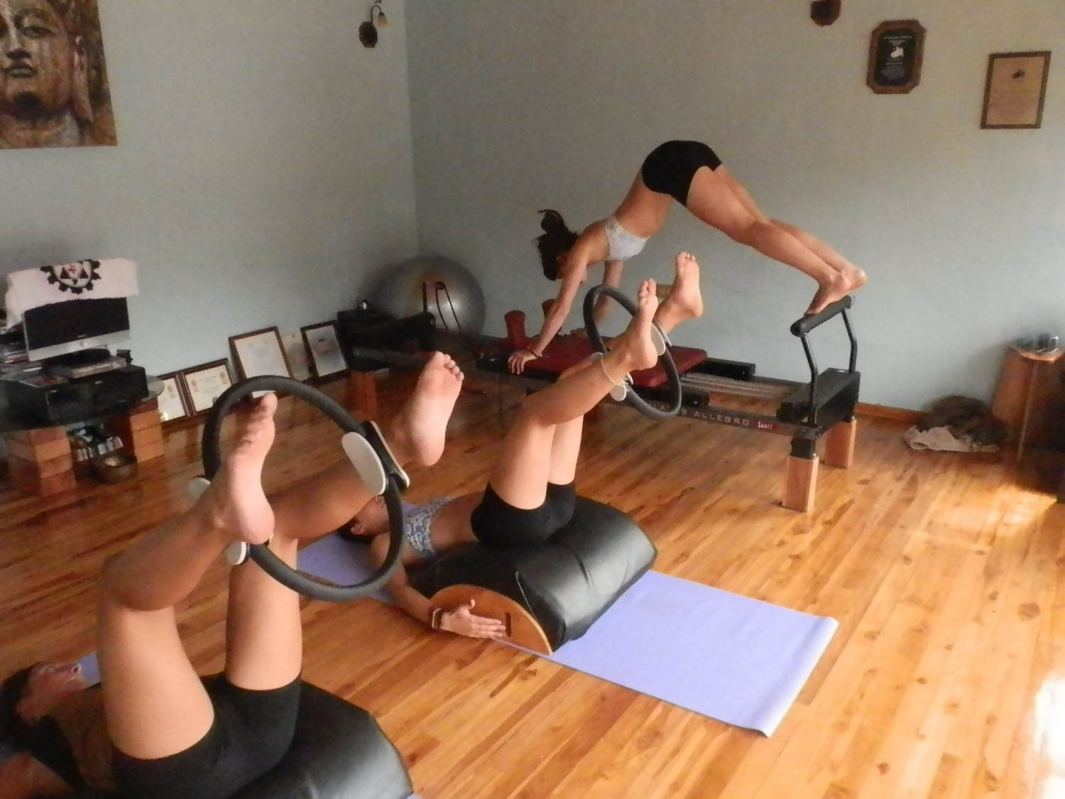 Three girls doing Pilates
